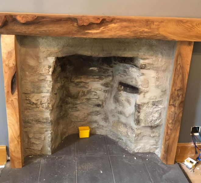 rustic timber mantlepiece